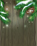 Old Wooden background with Christmas fir tree branches and snow. Empty space for your text Stock Images