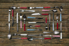 Old wooden background with a collection of cutlery composed with Stock Photos