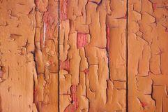 An old wooden background painted with paint with cracks, scratches and rub. stock images