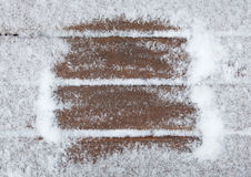 Old wooden background covered with snow. Christmas framework Stock Photos
