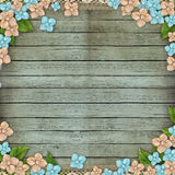 Old wooden background with flowers border Royalty Free Stock Photo