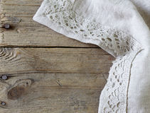 Old wooden background with gray lace napkin. Old wooden background with gray linen lace napkin Stock Photos