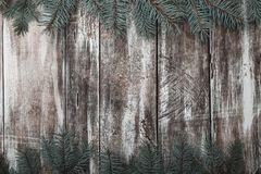 Old Wooden Background. Green Fir Branches At The Top And Bottom. Space For Congratulation Message Of Xmas, Christmas And New Year. Stock Photo