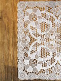 Old wooden background with  lace napkin Royalty Free Stock Image