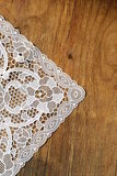 Old wooden background with  lace napkin Royalty Free Stock Photography