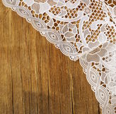 Old wooden background with  lace napkin Stock Image