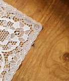 Old wooden background with  lace napkin Royalty Free Stock Images