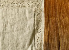Old wooden background with linen lace napkin Stock Image