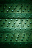 Old wooden background with metal rivets green color Royalty Free Stock Photography