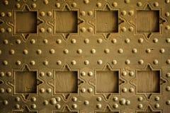 Old wooden background with metal rivets vintage door detail Stock Photos