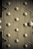 Old wooden background metal rivets vintage door Royalty Free Stock Photo