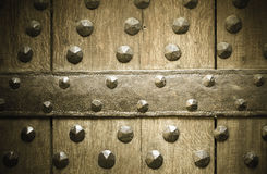 Old wooden background with metal rivets Stock Photos