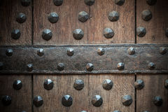 Old wooden background with metal rivets Stock Images