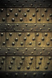 Old wooden background with metal rivets Royalty Free Stock Image