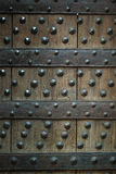 Old wooden background with metal rivets Royalty Free Stock Photos