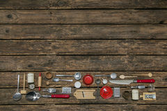 Old wooden background with old kitchenware decoration in red, si Stock Photos