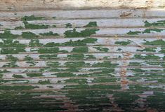 Old wooden background with remains of pieces of scraps of old paint on wood. Texture of an old tree, board with paint. Old blue board with cracked paint, vintage Stock Photography