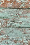 Emerald shade coloured cracked paint peeling on wood texture stock image