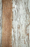 Old wooden background with sacking ribbon Stock Photos