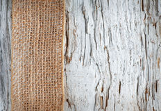 Old wooden background with sacking ribbon Stock Image