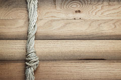 Old wooden background with ship rope Stock Photos