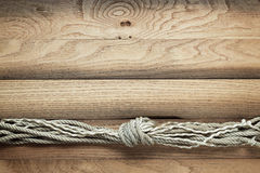 Old wooden background with ship rope Royalty Free Stock Photography