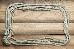 Old wooden background with ship rope Stock Photo