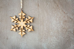 Old wooden background with snowflake Stock Images