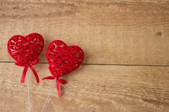 Two red hearts on a wooden background.Valentine Day Concept stock image