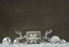 Old wooden background with white and silver grey christmas decor Royalty Free Stock Image