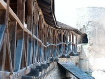 Old wooden balcony on the wall of the fortress Stock Image