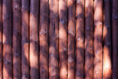 Old wooden balls planks fence Stock Photography