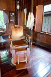 Old wooden barber's chair in barber shop Royalty Free Stock Images