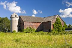 Old Wooden Barn. Vanishing Americana. Soon to be a sight only in your memory as the old wooden barns fall to the ground Royalty Free Stock Photography