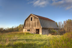 Old Wooden Barn. An old wooden barn on an abandoned farm in rural Prince Edward Island Canada Stock Image