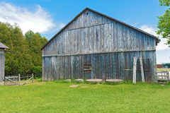 Old wooden barn against a blue sky. Stock Image