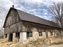 Old wooden barn against a blue sky Stock Photo