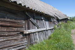 Old wooden barn. Closed door. Blue sky Stock Image