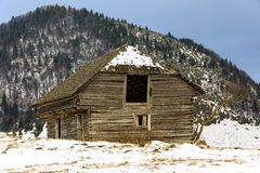 Old wooden barn in the countryside, in the winter Stock Image