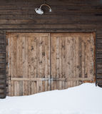 Old wooden barn door with light Royalty Free Stock Images