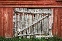 Old wooden barn door. Door on an old rustic red painted barn Royalty Free Stock Photos
