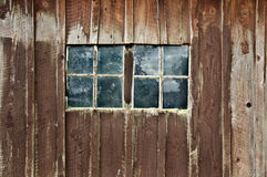 Old Wooden Barn with Double Windows. Reflection of trees in window panes royalty free stock photos