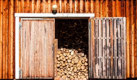 Old wooden barn with firewood. Old rustic wooden barn with firewood Royalty Free Stock Image