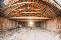 Old wooden barn full of old hay with light shining through the wooden boards. Stock Images