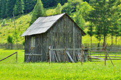 Old wooden barn. Wooden barn on the mountain meadow in summer season Royalty Free Stock Photography