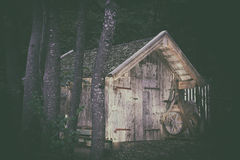 Old wooden barn next to trees Royalty Free Stock Image