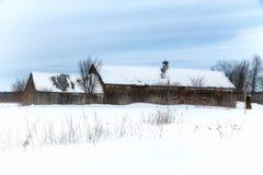 Old barn snow scene Stock Images