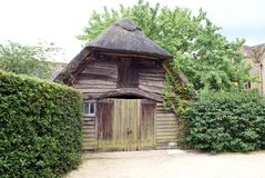 An old wooden barn with a thatched roof Stock Photography
