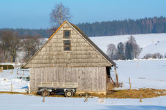 Old wooden barn with a wagon Royalty Free Stock Images