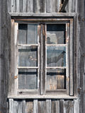 Old wooden barn window. With glasses cracked Stock Image